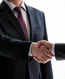 Businessmen shake hands Stock Images