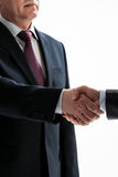 Businessmen shake hands Stock Photos