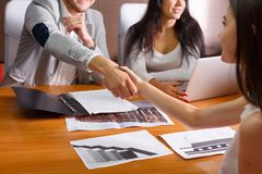 Businessmen shake hands at meeting royalty free stock images