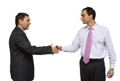 Businessmen shaking hands. Two smart businessmen shaking hands on a deal. Isolated on white royalty free stock photography
