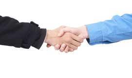 Businessmen shaking hands. Two businessmen shaking hands in agreement. Isolated on white background Royalty Free Stock Photography