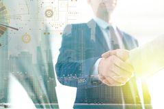 Businessmen shaking hands against cityscape. Double exposure stock images