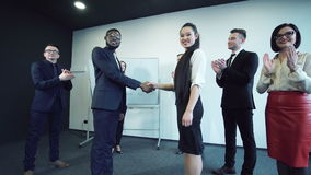 Businessmen shaking hands stock video footage