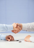 Businessmen shaking hands. Blue background royalty free stock photos
