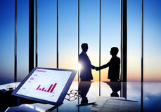 Businessmen Shaking Hands In A Board Room Royalty Free Stock Photography
