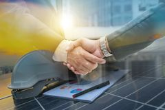 Businessmen are shaking hands for business venture and Marketing royalty free stock photo