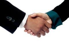Businessmen shaking hands, closeup shot. Stock Photography