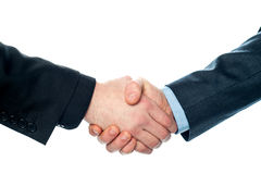 Businessmen shaking hands, closeup shot. Stock Photo