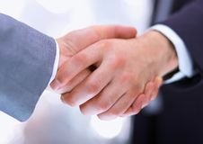 Businessmen shaking hands, isolated on white. Royalty Free Stock Image