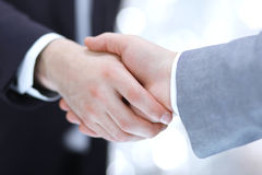 Businessmen shaking hands, isolated on white. Royalty Free Stock Photo