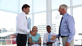 Businessmen shaking hands in the meeting room