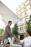 Businessmen Shaking Hands At Outdoor Cafe Royalty Free Stock Photos