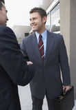Businessmen Shaking Hands Outside Office Stock Photos