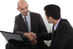 Businessmen shaking hands Stock Image