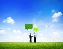 Businessmen Shaking hands With Speech Bubble Stock Photo