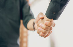 Businessmen are shaking hands after successful negotiations in business, The concept of business advancement through collaboration Royalty Free Stock Image