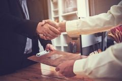 Businessmen shaking hands After successfully completing the inve. Stment and life insurance contract at office royalty free stock images