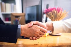 Businessmen shaking hands After successfully completing the inve. Stment and life insurance contract at office royalty free stock photo