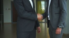 Businessmen shaking hands. Two confident businessmen shaking hands. Two confident businessmen shaking hands and ,two businessmen met in the office and shake stock video footage
