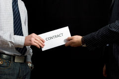 Businessmen sharing a contract Stock Images