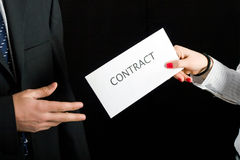 Businessmen sharing a contract Stock Image