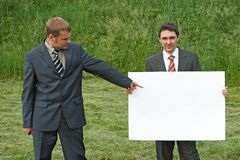 Businessmen and sheet of paper Royalty Free Stock Images