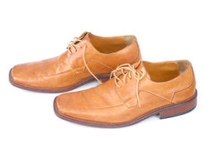 Businessmen Shoes. Pair of brown male shoes over white Stock Photo