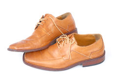 Businessmen Shoes. Pair of brown male shoes over white Stock Photos