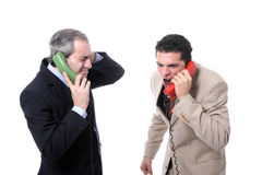 Businessmen shouting on the phone. Isolated on white - Studio shot Stock Images