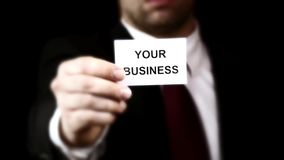 Businessmen showing a card with text stock footage