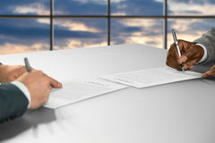 Businessmen sign contracts at sunset. royalty free stock photo