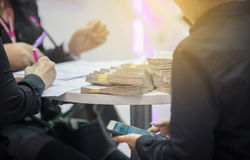 Businessmen are signing financial contracts and having money pu stock photos