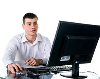 Businessmen sits at the computer Stock Photos