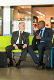 Businessmen sitting airport Royalty Free Stock Images
