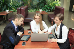 Businessmen sitting in cafe for a laptop Royalty Free Stock Photo