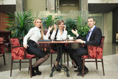 Businessmen sitting in cafe for a laptop Royalty Free Stock Images