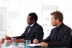 Businessmen sitting in a meeting Stock Image