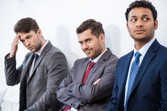 Businessmen sitting in queue and waiting for interview in office Royalty Free Stock Images