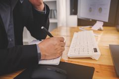 Businessmen are sitting at the working space and review ideas an. D planning project to investment royalty free stock image