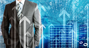 Businessmen with skyscrapers, graphs and arrows Stock Photography