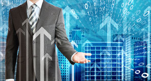 Businessmen with skyscrapers, graphs and arrows. Concept growth in business Stock Images