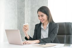 Businessmen smiled at coffee / tea and used a tablet computer at Royalty Free Stock Image