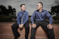 Businessmen smiling and talking Royalty Free Stock Photography