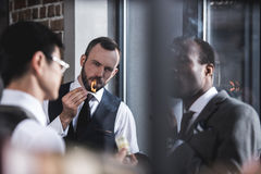 Businessmen smoking cigars together during break Stock Photo