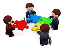 Businessmen solving jigsaw puzzle Royalty Free Stock Photography