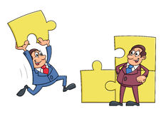 Businessmen solving puzzle Royalty Free Stock Photo