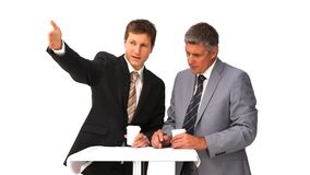 Businessmen speaking about a building project stock footage