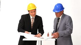 Businessmen speaking about a building project stock video