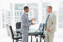 Businessmen speaking in the conference room Royalty Free Stock Images