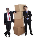 Businessmen with stack of boxes Royalty Free Stock Photo